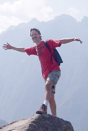 Bryan Nelson standing on top of a mountain in Peru.